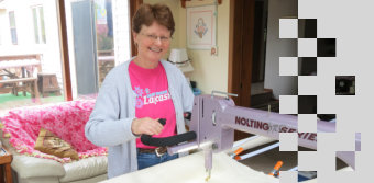Nancy learning to use her Pro 24 Nolting longarm quilting machine